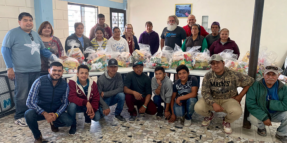 Volunteers in Reynosa with their grocery packages