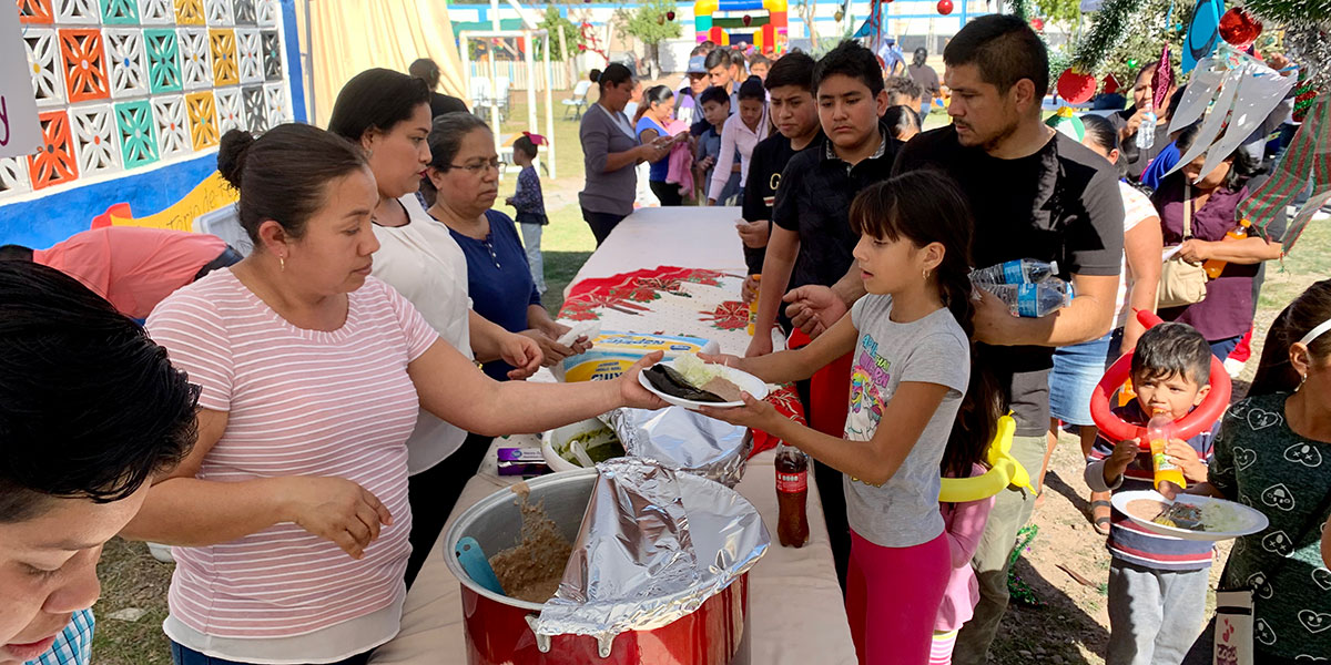 Members of the church serving food at the Christmas fiesta in Naranjito