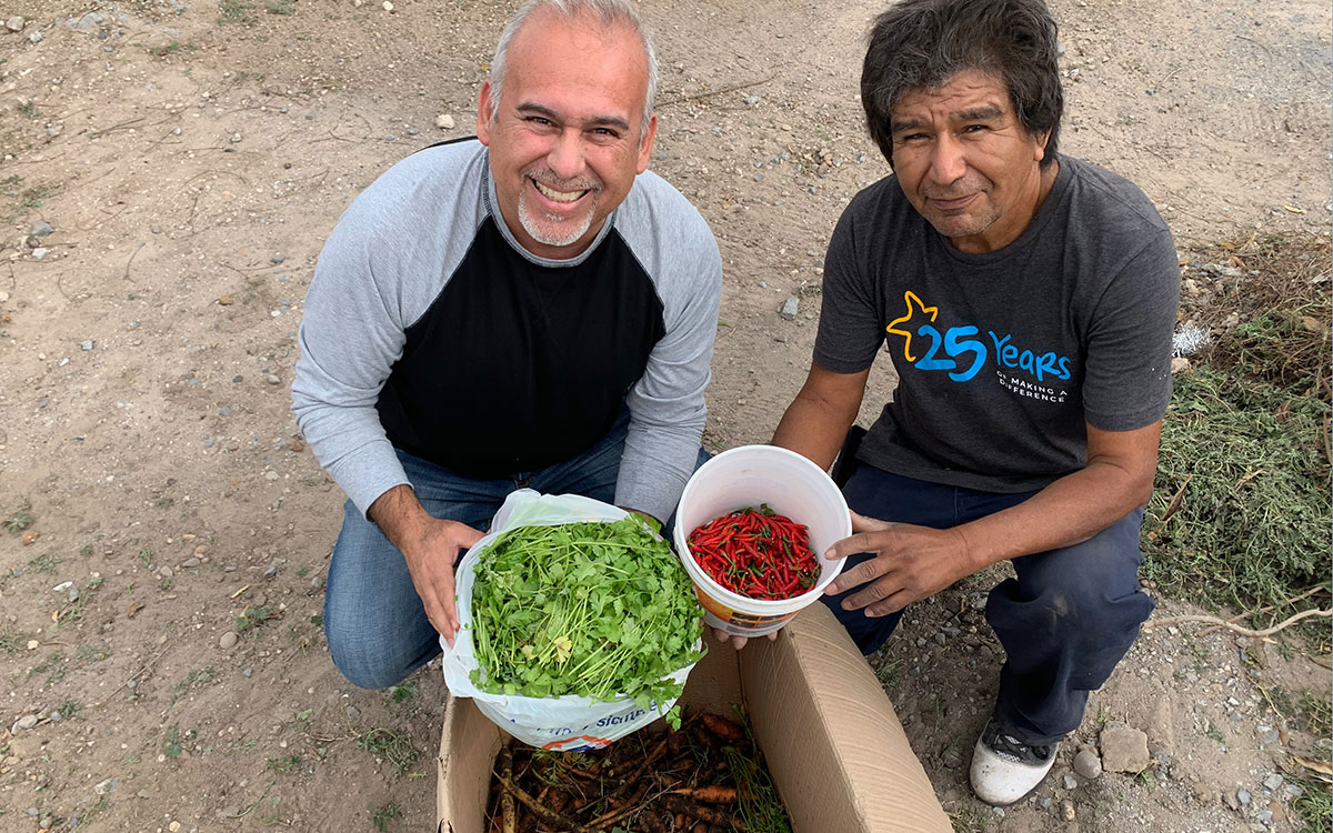 David and our garden caretaker Jose with the new crops from the garden in Mexico