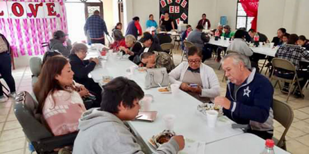 Enjoying a meal together at the Valentines Day fiesta in Miguel Aleman