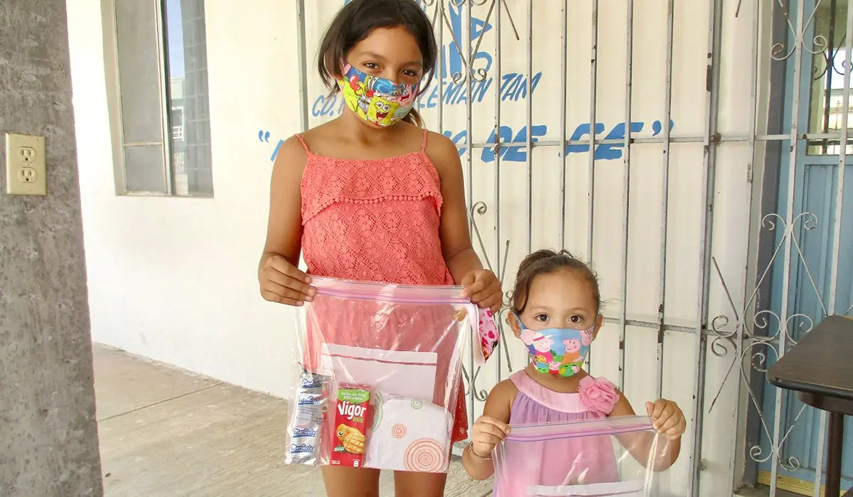 Kids with their grab and go meals from the children nutrition program in Miguel Aleman Mexico