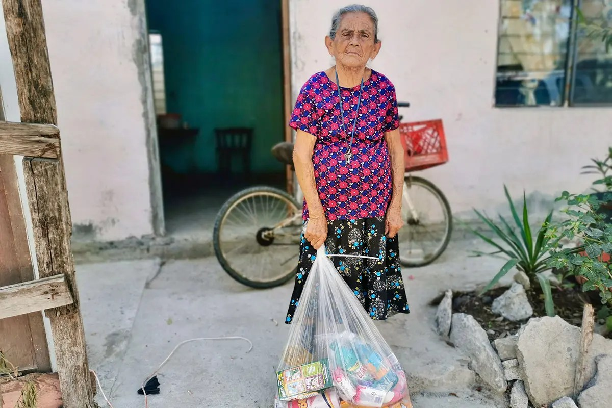 Distributing grocery packages to families in Reynosa Mexico