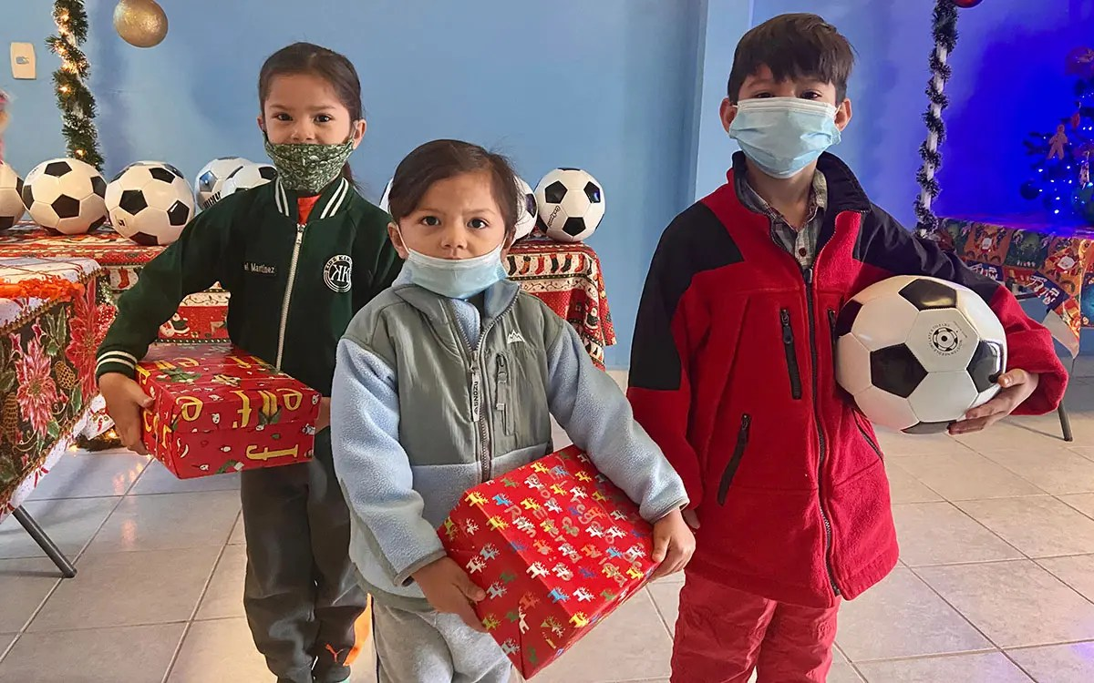 Kids receiving gifts for Christmas in Reynosa Mexico