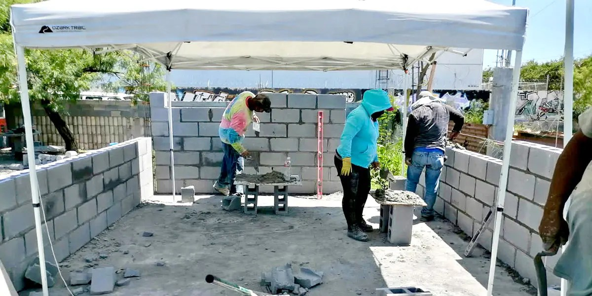 Our staff and volunteers laying blocks to build the walls of Casa 5 in Reynosa Mexico