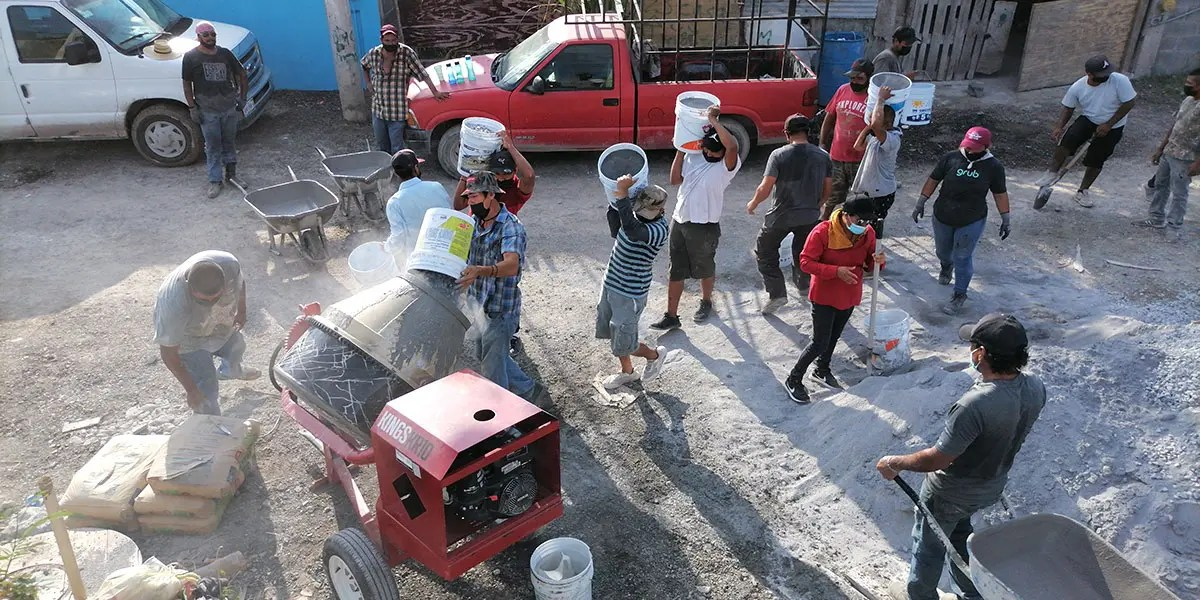 Our staff and volunteers pouring the floor of Casa 6 in Reynosa Mexico