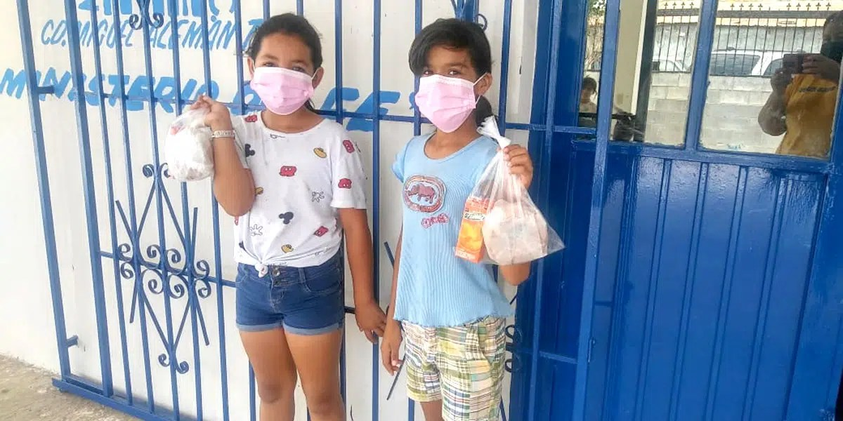 The kids with their meals at the nutrition program in Miguel Aleman Mexico
