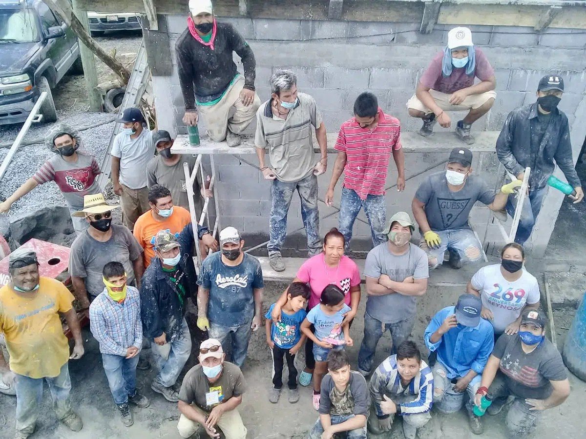 Our staff and volunteers with the family of Casa 6 after pouring the roof of the house