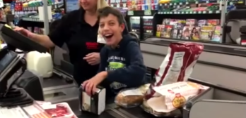 boy with cerebral palsy scans groceries