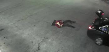 surveillance video woman escapes kidnapper