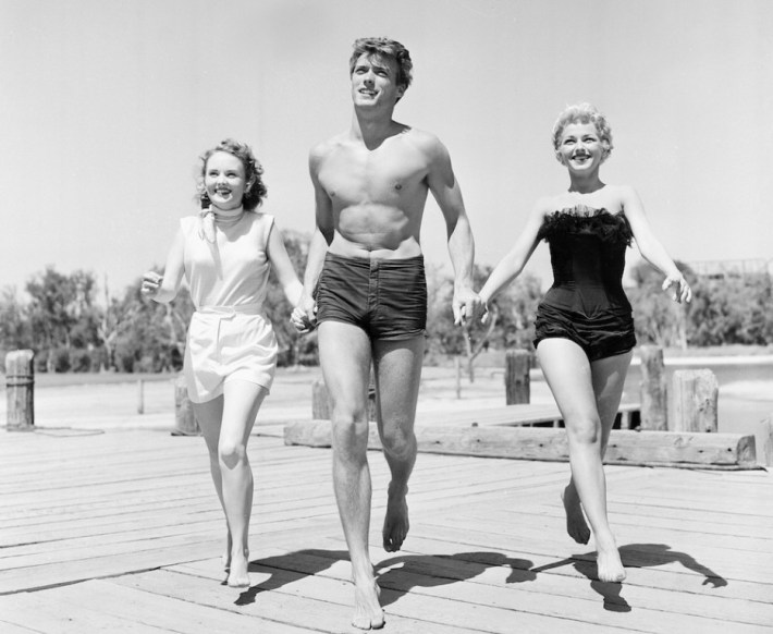Clint Eastwood with actresses Olive Sturgess and Dani Crayne in San Francisco, 1954.