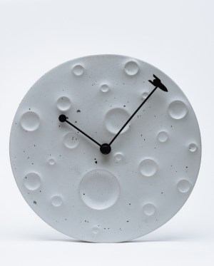 "Wall clock made of concrete in the form of the moon ""Around the Moon in 60 Minutes"" Active"