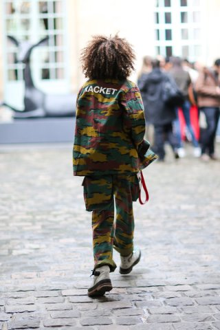 PARIS, FRANCE - FEBRUARY 28: A guest wears a Racket military camouflage print suit, outside the JOUR/NE show, during Paris Fashion Week Womenswear Fall/Winter 2017/2018, on February 28, 2017 in Paris, France. (Photo by Edward Berthelot/Getty Images)