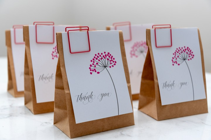 Favor bags with printable pink dandelion tags