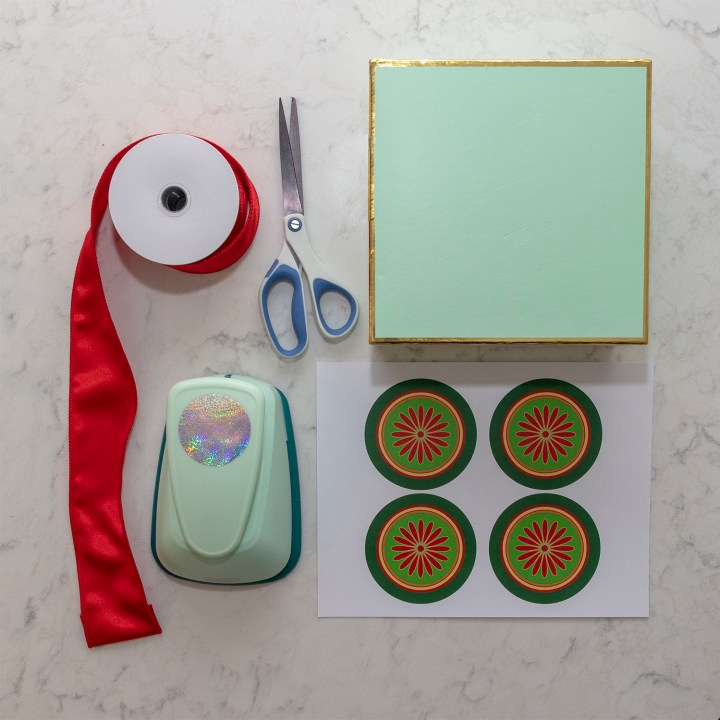Scissors, ribbon, tags, hole punch, gift box