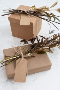 Use metallic gold spray paint and kraft paper to create beautiful packages
