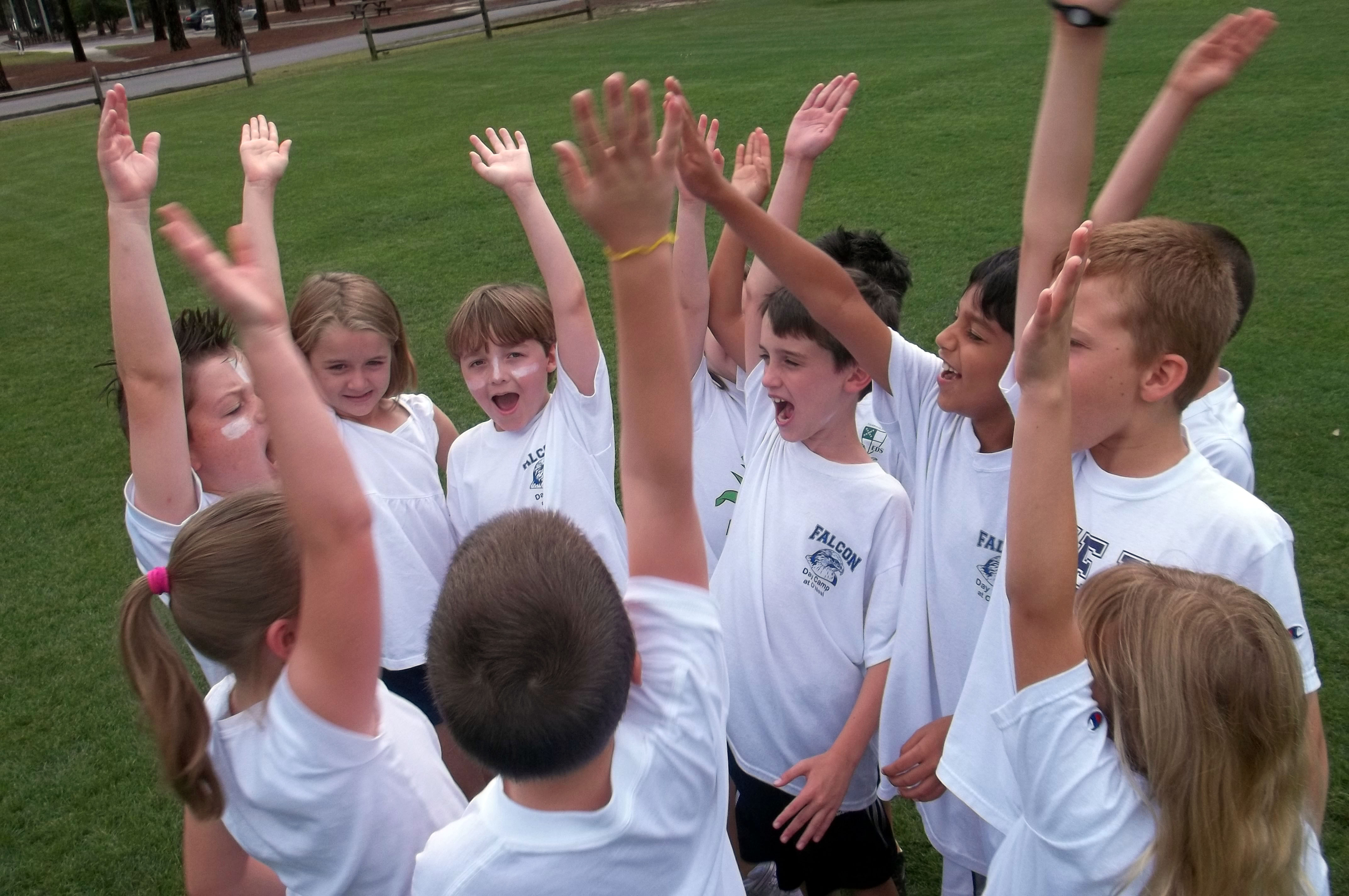 Field day team members at a private school rally.