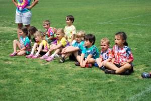 Preschool students watch older students on Field Day 2014