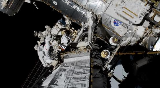 NASA Astronauts Christina Koch and Jessica Meir outside the International Space Station in Space