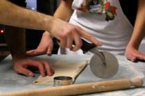 cutting it in the shape of tagliatelle