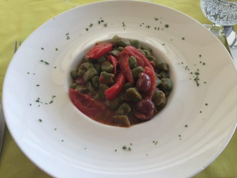 Kat's green gnocchi with tomatoes, olives and caper sauce. Photo by Kat