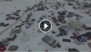 View of the camp after the blizzard. Our tent is the green one at the 2:25 mark, in the lower left hand corner. Facebook Live Video by Myron Dewey / Indigenous Rising Media.