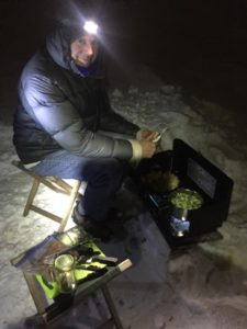 Ed assisting with dinner on a camp stove, peeling potatoes from his garden in Des Moines as Lyssa boils brussels sprouts and prepares vegetarian meatloaf. Photo by Lyssa Wade.