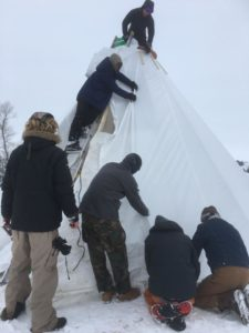 Tipi under construction during the storm.