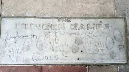 One of the many concrete slabs housing celebrity hand and footprints. Happy Hunger Games.