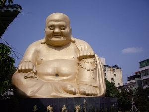 Estatueta em marfim de Hotei, deus chinês da magnanimidade, Buda da Prosperidade