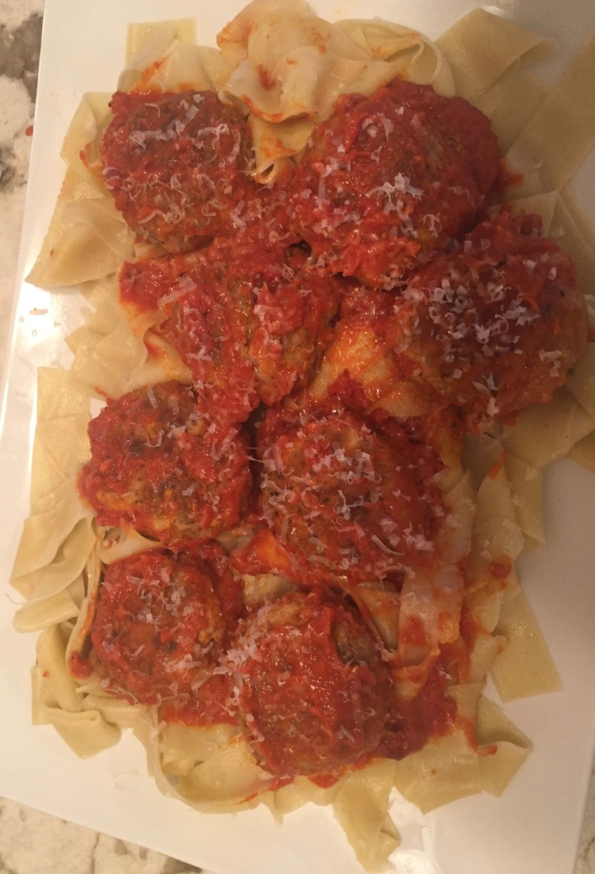 Meatballs with Stuffing in Sauce Over Pasta