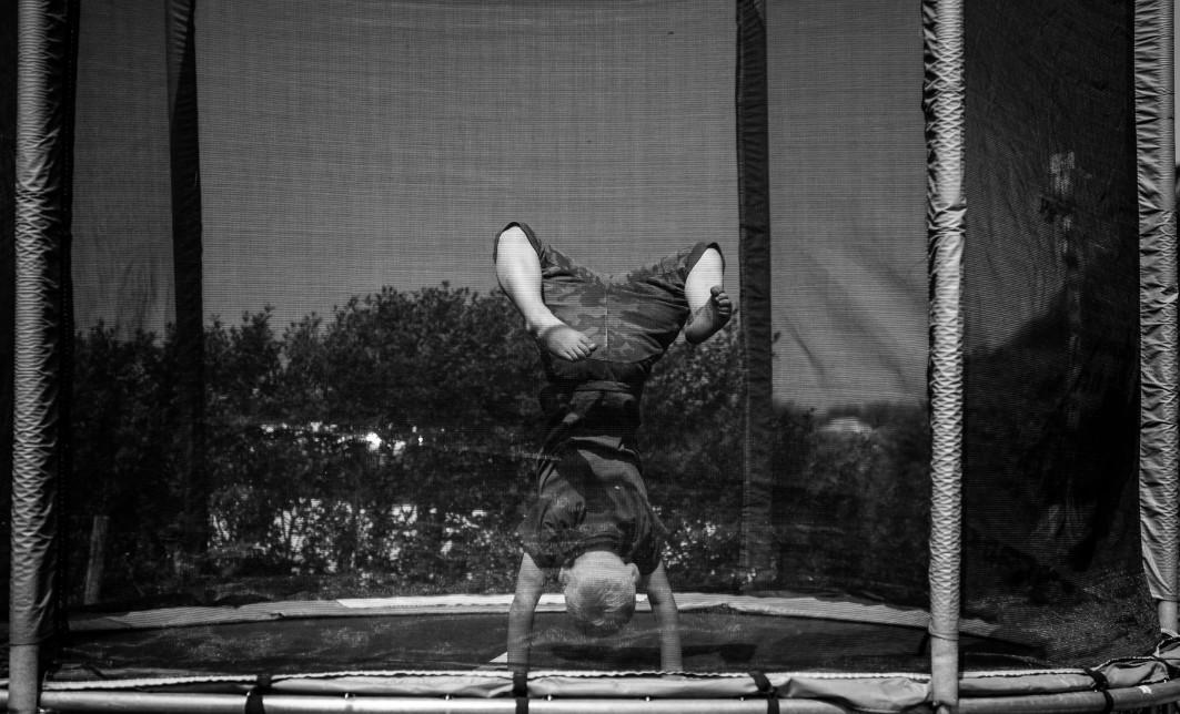 Child doing tricks on a trampoline