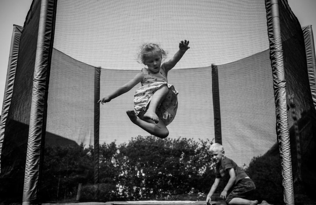 Children doing tricks on a trampoline