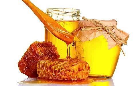 menghilangkan bekas jerawat di wajah dengan madu