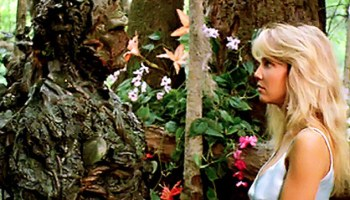 Swamp Thing (Dick Durock) and Heather Locklear