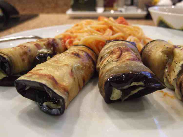 aubergine rolls with spaghetti and tomato sauce