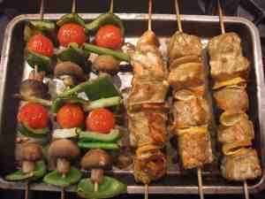 Moroccan spiced salmon skewers & vegetable kebabs.