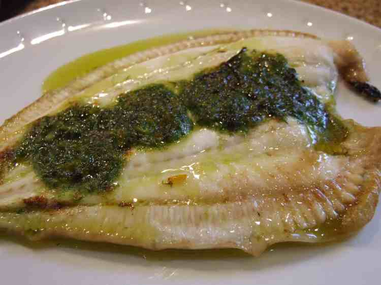 Plaice grilled with orange herb butter.