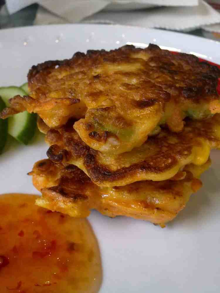 Sweetcorn and carrot fritters with sweet chilli sauce.