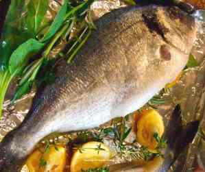 Whole sea bream with herbs and lemon.