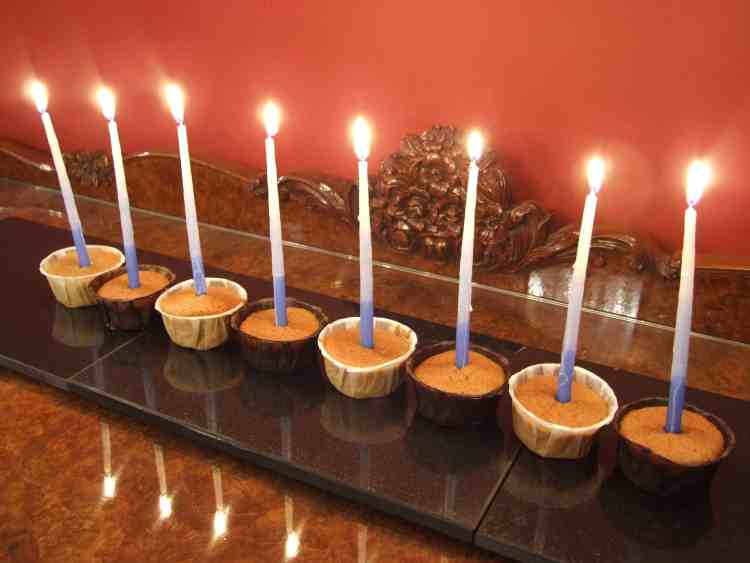 Olive oil cupcake menorah. Moist, lightly spiced & with a subtle olive oil flavour, these delicious cupcakes are an unusual Chanukah treat. Perfect when you can't face another latke!