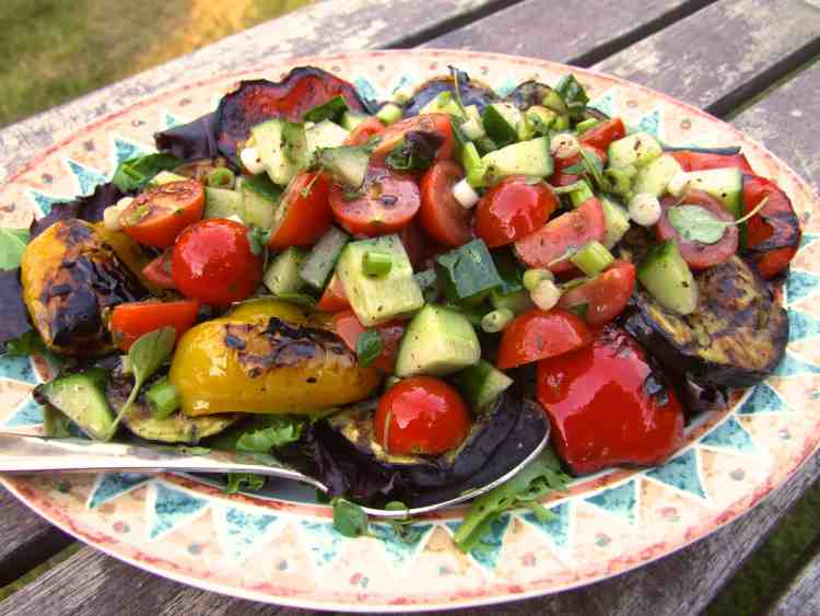 Layers of char-grilled vegetables, salad leaves, crunchy cucumber & juicy tomatoes are drizzled with black-olive dressing for a simple & delicious side-dish