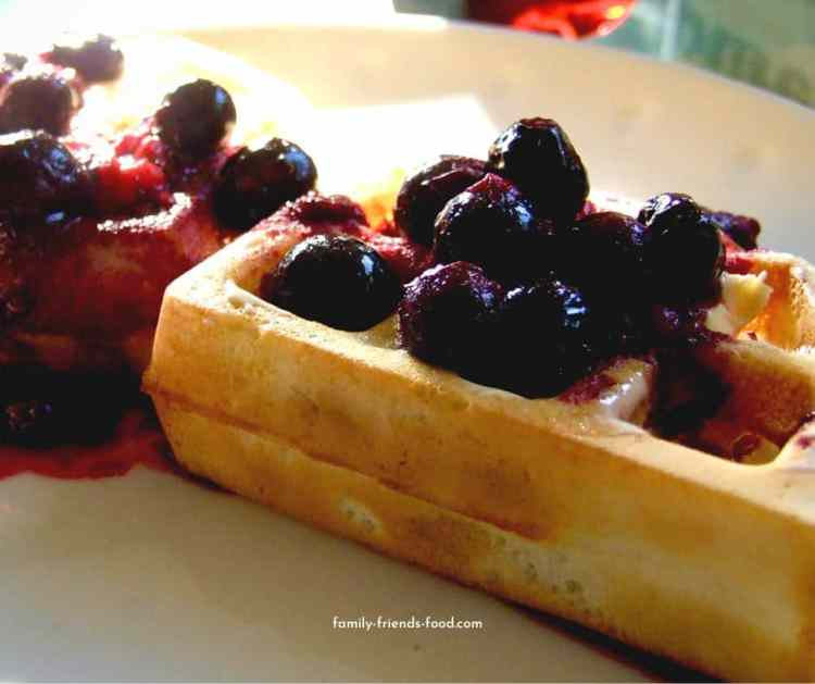 Waffles topped with berry compote.