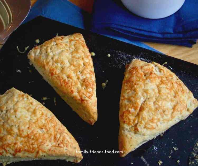 Herb and cheese scones on a tray.
