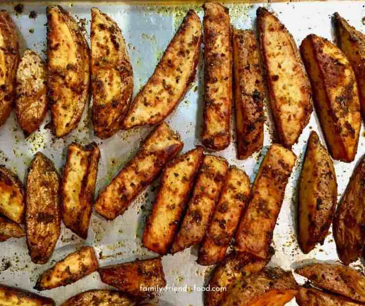 Tray of baked potato wedges.