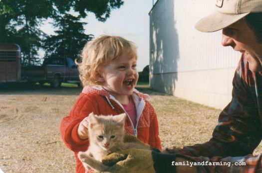 Child with farm cat