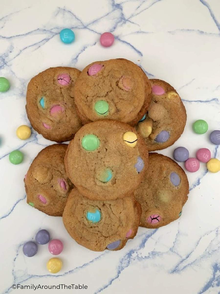 Overhead photo of Easter M&M cookies on a marbled service.