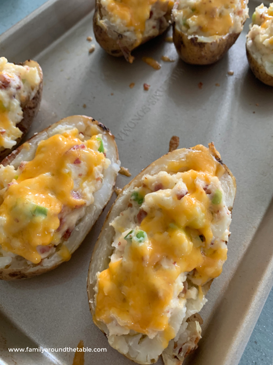 Twice baked potatoes on a baking sheet.
