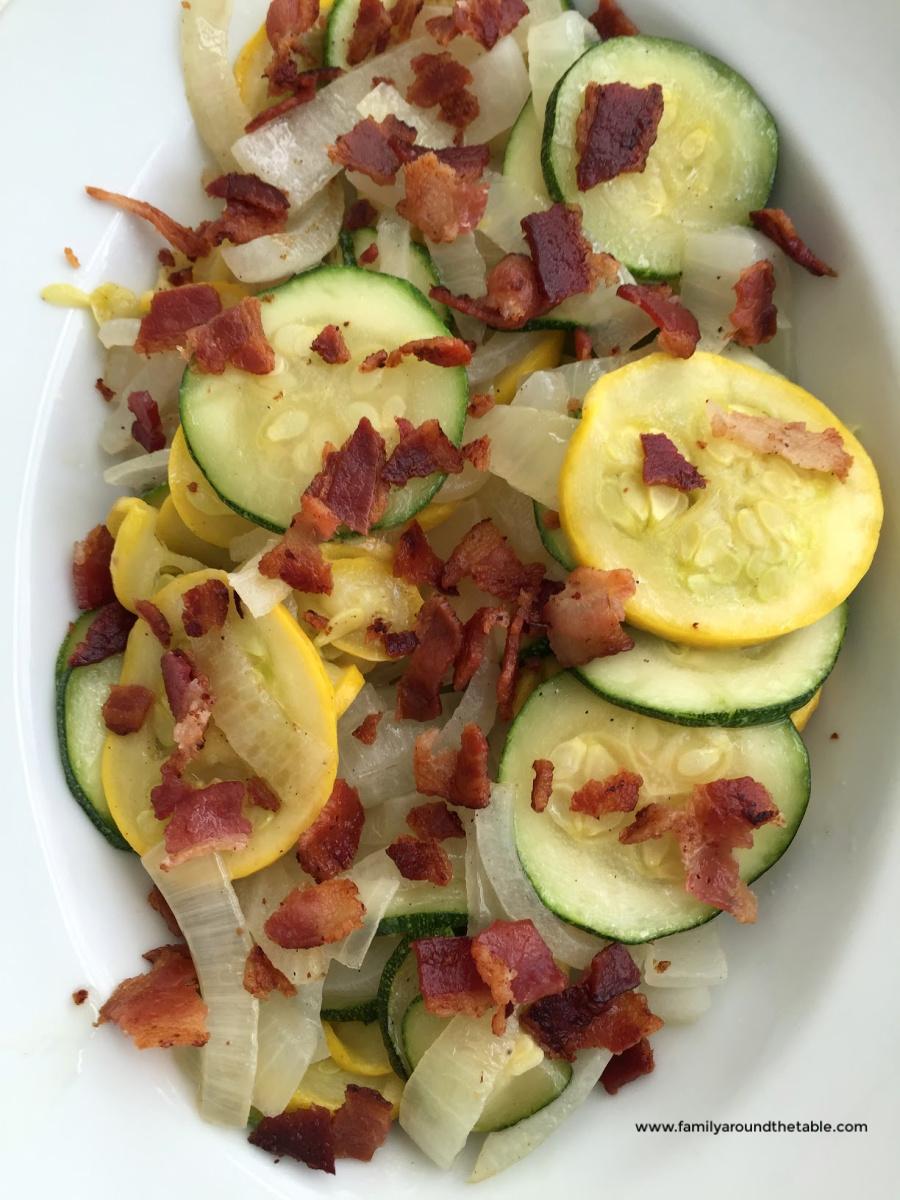 Sautéed vegetables in a white serving bowl.
