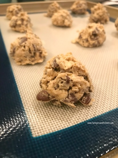 Oatmeal chocolate chip cookies and a glass of milk make a great after school snack.