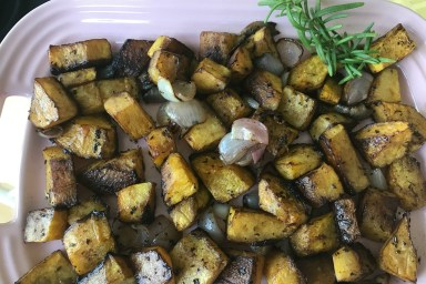 Roasted acorn squash and shallots is a nice side dish for any meal.